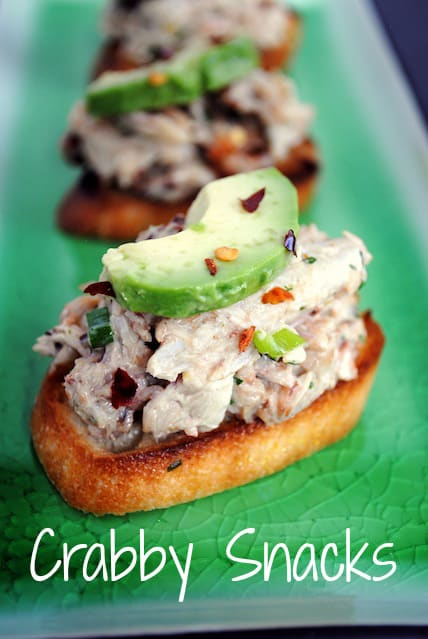 "Crabby Snacks - Crunchy crostini topped with cold crab salad and creamy avocado. Inspired by ""Silver Linings Playbook."" 
