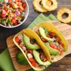 Grilled Pork Tacos with Pineapple Salsa - slightly spicy grilled pork with a sweet and savory pineapple salsa. The perfect summer meal!