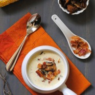 "Sweet Corn & Wild Mushroom Soup - A creamy summer soup celebrating the season's sweet corn. Topped with crispy bacon and seared wild mushrooms. From Michael Symon's ""Live To Cook"" cookbook."