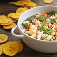 Sweet and Spicy Black Bean Dip with Plantain Chips - creamy mashed black beans topped with queso fresco and juicy pineapple.