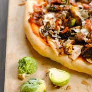 Bacon & Brussels Pizza - thin pizza crust topped with roasted brussels sprouts, crispy bacon, caramelized onion, mushrooms and shaved Parmesan cheese. | foxeslovelemons.com