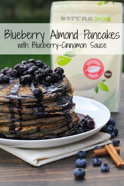 Blueberry Almond Pancakes with Blueberry-Cinnamon Sauce - a healthful and tasty breakfast made with nuts, fruit and whole-grain flour. | foxeslovelemons.com