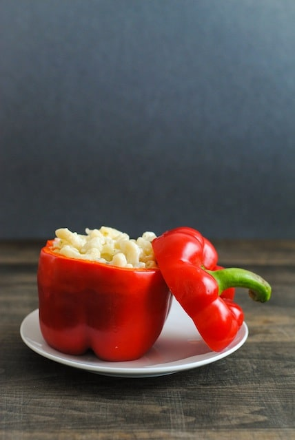 Italian Mac & Cheese Stuffed Peppers - Creamy pasta with lots of cheese and herbs stuffed into red peppers and roasted. | foxeslovelemons.com