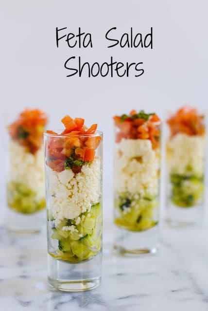 Feta Salad Shooters - layers of crunchy cucumber, tangy feta cheese, and fresh tomato and basil. A perfect, simple party bite for the summer! | foxeslovelemons.com