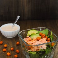 Salmon & Crispy Chickpea Spinach Salad - Fresh spinach, broiled salmon, creamy avocado and crunchy chickpeas with a chipotle-lime Greek yogurt dressing.