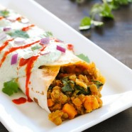 The Big Ol' Lentil Burrito - A meatless but filling burrito filled with lentils and sweet potatoes, and topped with a creamy yogurt sauce.