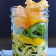 Asian Zoodle Salad Jars - Spiralized zucchini noodles, yellow bell pepper, sugar snap peas, mandarin oranges, crunchy wonton strips and sesame-ginger dressing. A portable and healthful make-ahead lunch!