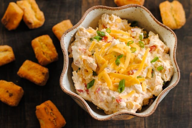 Lightened-Up Pimento Cheese Dip - Nobody will know this cheesy and tangy dip is lightened-up with Greek yogurt! | foxeslovelemons.com