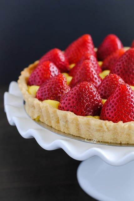 Strawberry Tart with Moscato Lemon Curd - An elegant and beautiful summer dessert that tastes like strawberry lemonade with a hint of moscato wine! | foxeslovelemons.com