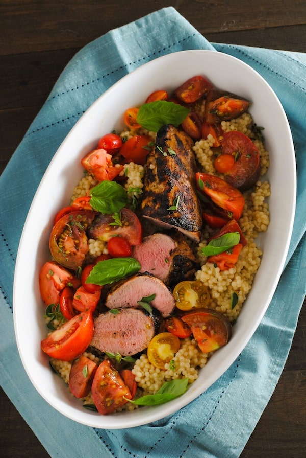 Grilled Pork Tenderloin with Couscous & Heirloom Tomato Salad - A summer meal that's as delicious as it is beautiful. | foxeslovelemons.com