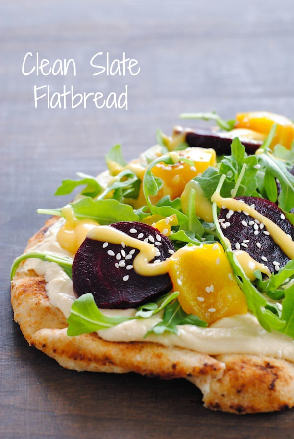 Clean Slate Flatbread - Whole wheat naan topped with hummus, roasted yellow peppers and beets, arugula, sesame seeds and honey mustard. | foxeslovelemons.com