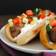 Lebanese Beef Kafta Dogs - A 20-minute weeknight meal! A hot dog-style version of beef kafta, topped with Greek yogurt sauce, cucumber and tomato. | foxeslovelemons.com