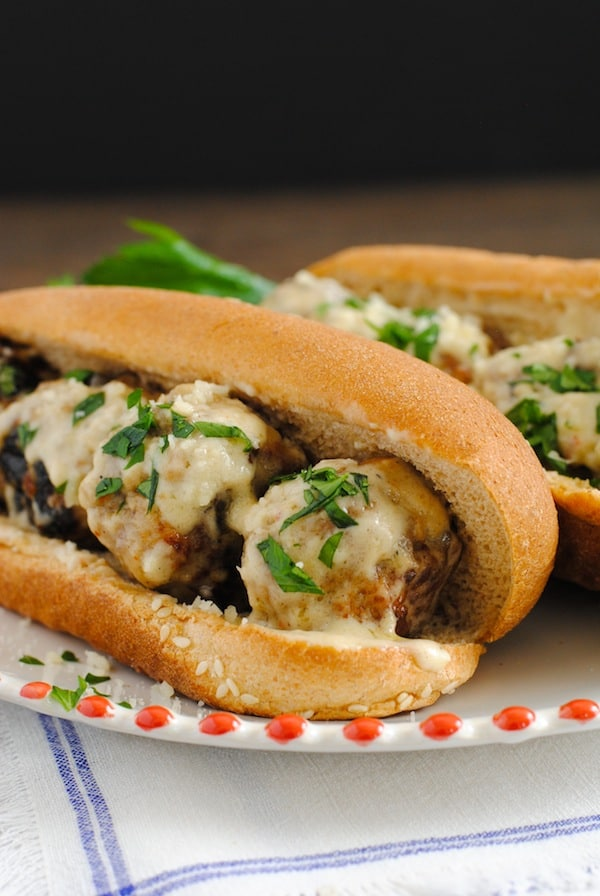 Meatball Subs with Garlic-White Wine Sauce - Perfect for tailgating and game-watching parties! Can be kept warm in a slow cooker until ready to serve. | foxeslovelemons.com