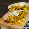 Curried Turkey Pitas - This nutritious meal comes together in less than 30 minutes! Lean ground turkey is flavored with curry powder and sweet golden raisins, and topped with mango and an herbed yogurt sauce. | foxeslovelemons.com