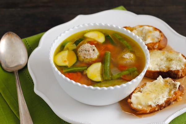 Turkey Meatball & Vegetable Soup with Cheesy Crostini - Turn a bowl of vegetable soup into a meal by adding nutritious turkey meatballs and serving it with crunchy, cheesy crostini. | foxeslovelemons.com