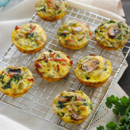 Make-Ahead Breakfast Muffins - Make these bacon, mushroom, kale and sundried tomato filled egg muffins in advance, then freeze them. In just a minute in the microwave, you'll have a healthy and tasty hot breakfast! Perfect for hosting house guests, parties and busy weekday mornings. | foxeslovelemons.com