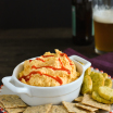 Spicy Beer Cheese Dip - A party favorite! Dip a cracker into it, or spread it on a sandwich! | foxeslovelemons.com