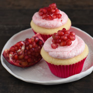 Almond & Pomegranate Cupcakes - Fluffy almond-flavored white cupcakes topped with creamy pomegranate-infused frosting. | foxeslovelemons.com